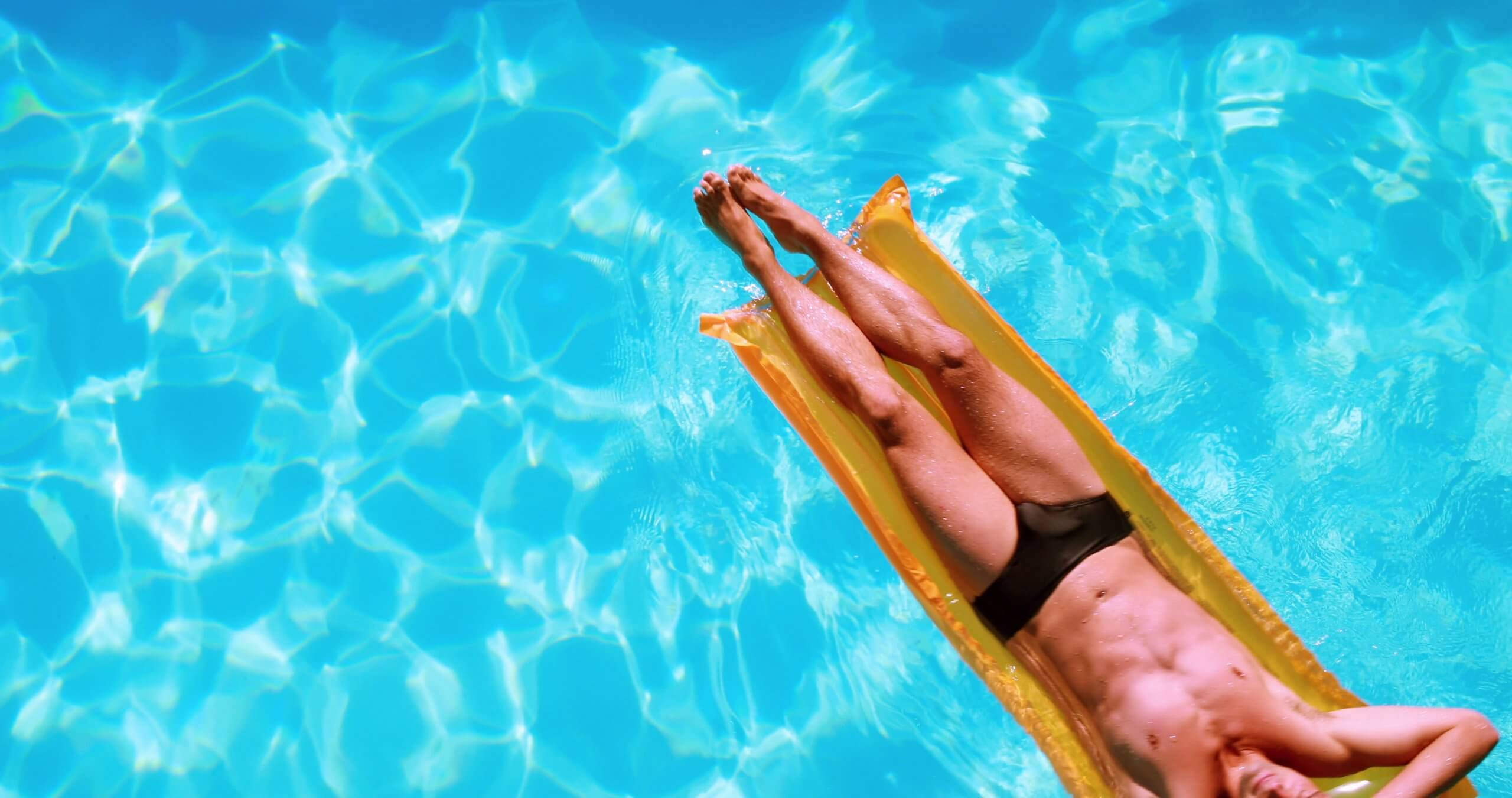 man floating in pool - Gateway Physiotherapy